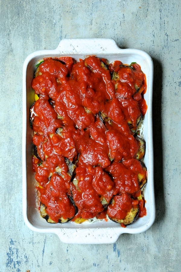 Photo of casserole with marinara sauce topping.