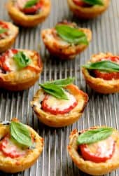 Mini Southern Tomato Pies - Another shot on cooling rack garnished with fresh basil