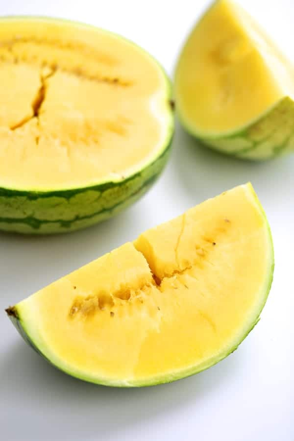 Photo of yellow watermelon cut into pieces.
