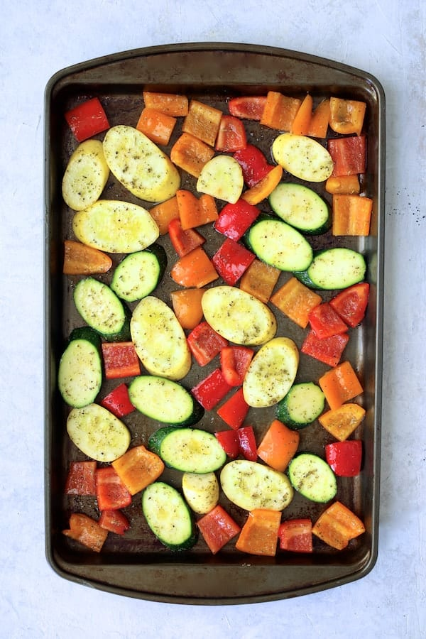 Mediterranean Sheet Pan Chicken Sausage and Vegetables with Garlic Parmesan Polenta - Cut vegetables on sheet pan ready for the oven