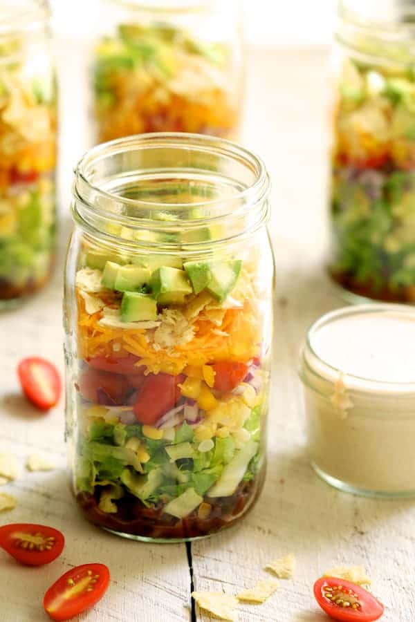 Southwest Layered Salad - Salad from a different angle on white wooden background