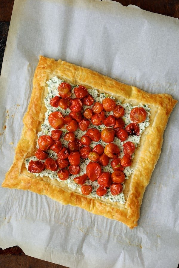 Roasted Cherry Tomato Tart with Herbed Ricotta - Tart with cherry tomatoes on the ricotta mixture