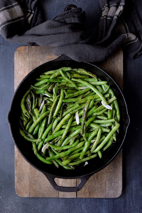 Skillet Charred Green Beans with Goat Cheese Chipotle Butter - Beans in cast iron skillet after charring before butter
