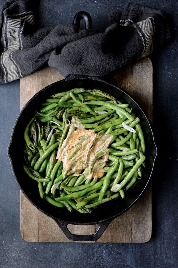 Skillet Charred Green Beans with Goat Cheese Chipotle Butter - Beans in cast iron skillet with butter added