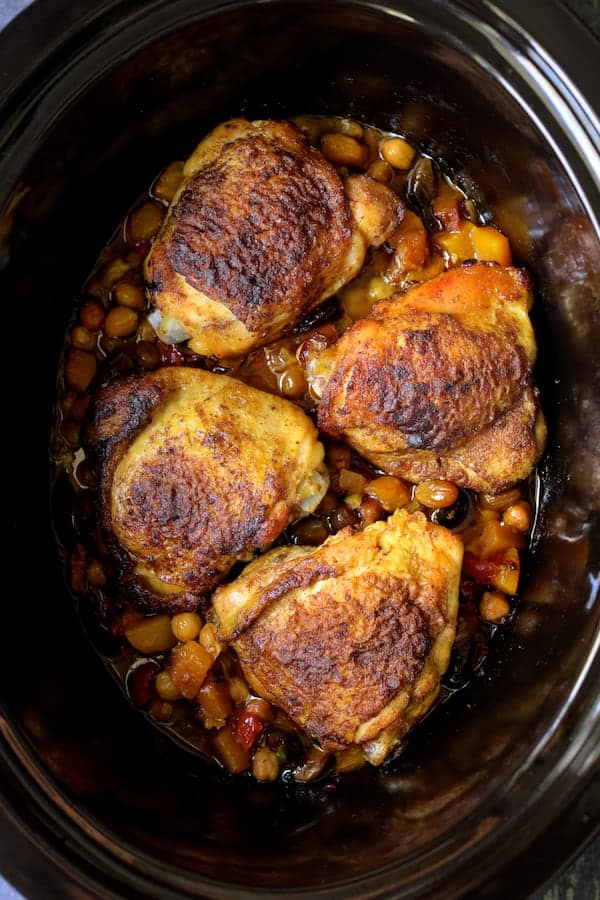 Moroccan Chicken Tagine with Butternut Squash Chickpeas and Olives - Overhead shot of dish still in slow cooker after cooking
