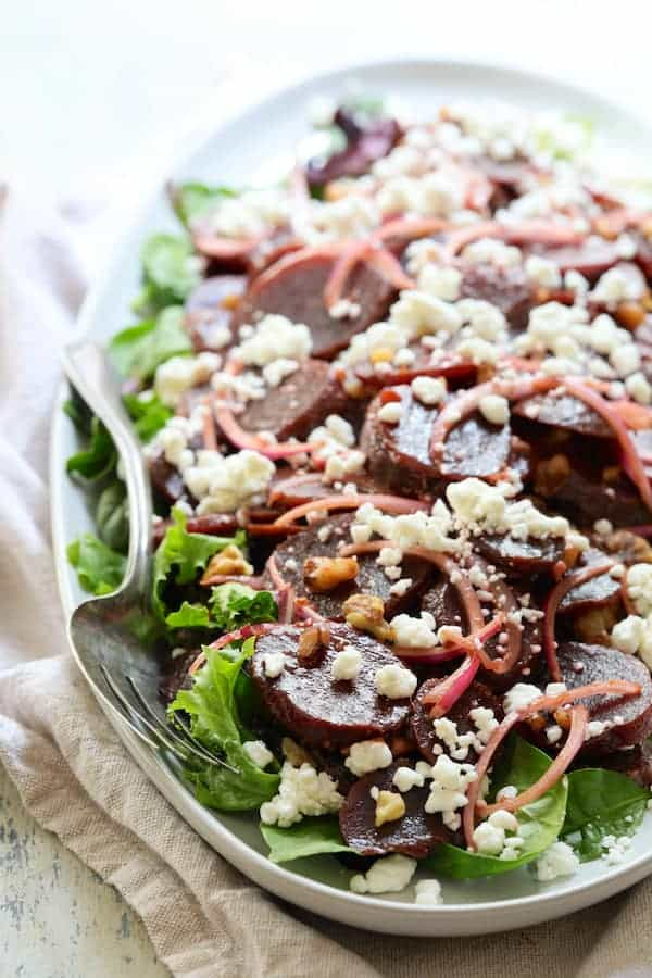 Roasted Beet Salad with Walnuts Goat Cheese and Honey Balsamic Dressing - Close-up of salad taken from the front