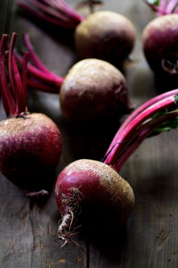 Roasted Beet Salad with Walnuts Goat Cheese and Honey Balsamic Dressing - Photo of raw, whole beets with tops still on