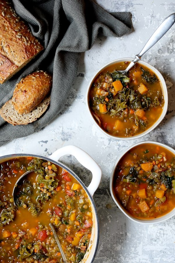 Spicy Kale Butternut Squash and Lentil Soup with Bacon - Overhead shot with soup served in soup bowls
