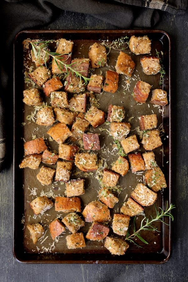 Whole Grain Thyme Rosemary and Parmesan Croutons - Croutons on baking sheet before being baked
