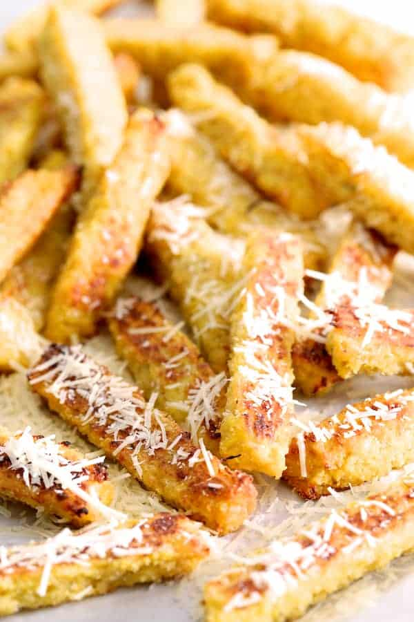 Spaghetti Squash Fries - Messy pile of spaghetti squash fries sprinkled with Parmesan cheese