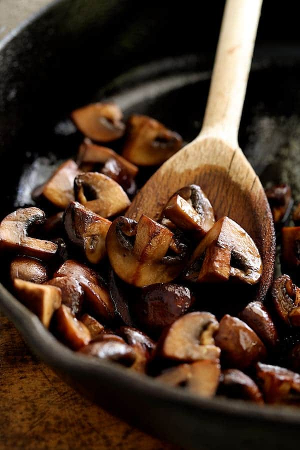 Boneless Beef Short Ribs Bourguignon - Mushrooms being sauteed in cast iron skillet