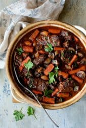 Boneless Beef Short Ribs Bourguignon - Closer overhead shot of dish in clay serving dish
