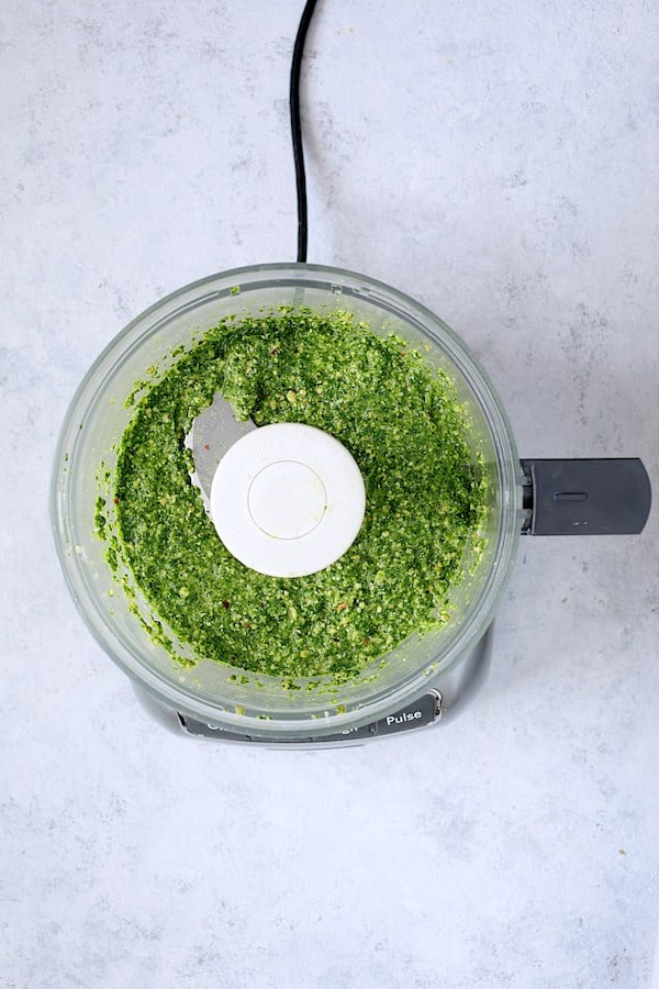 Modern Table Pasta with Creamy Cashew and Spinach Pesto Sauce - Overhead shot of pesto in food processor