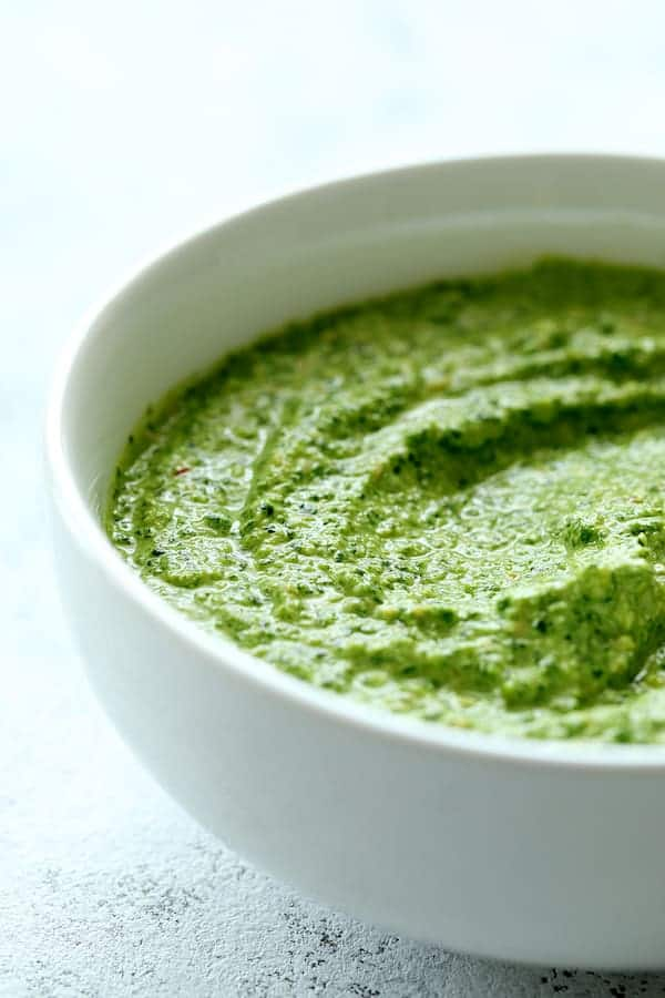 Modern Table Pasta with Creamy Cashew and Spinach Pesto Sauce - Front view of finished creamy pesto sauce in white bowl