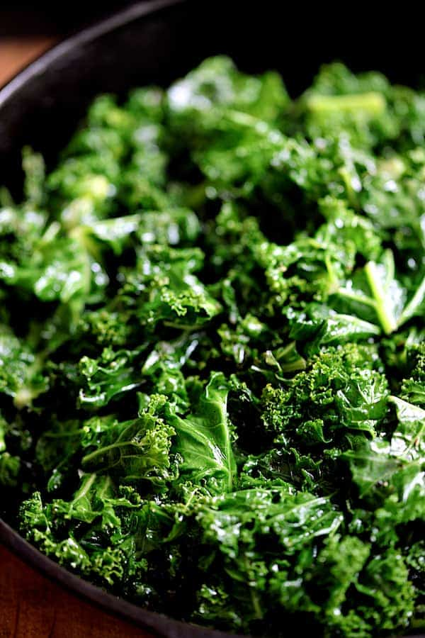 Spicy Sautéed Kale with Andouille Sausage - Close-up of kale in cast iron skillet