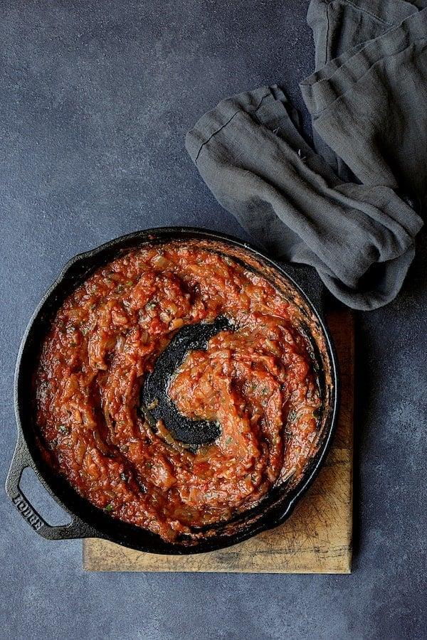 Turkish Eggplant Casserole - Imam Bayildi - Overhead shot of tomato sauce in cast iron skillet
