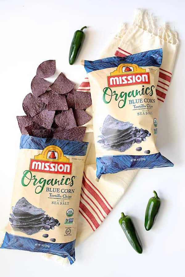 Spinach Artichoke Dip with Fresh Jalapeno - Two bags of Mission chips with tortillas spilling out of one of them