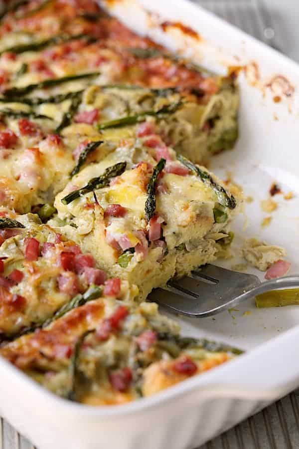 Breakfast Strata with Asparagus, Artichokes, Ham and Gruyere - Close-up shot of piece of strata being served