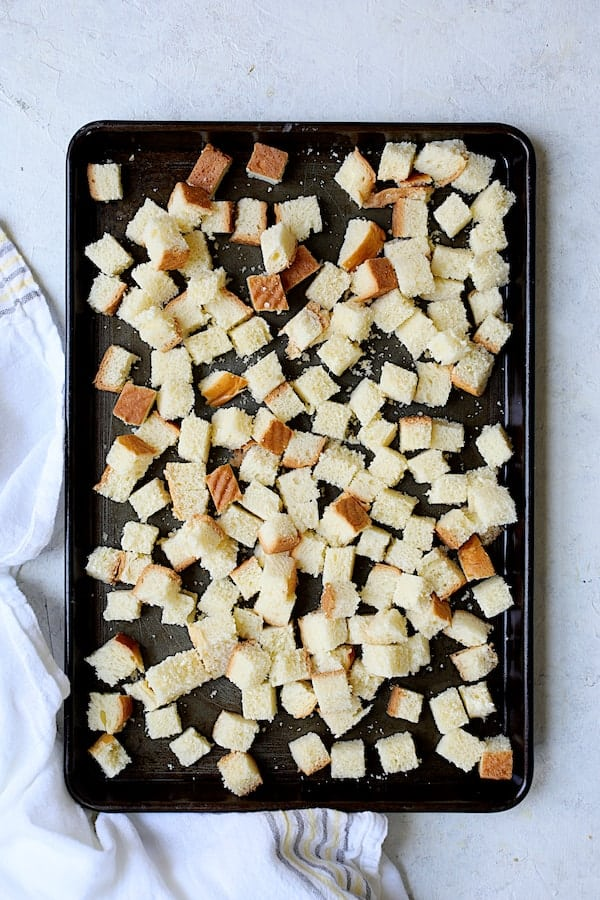 Brioche bread cubes on a baking sheet