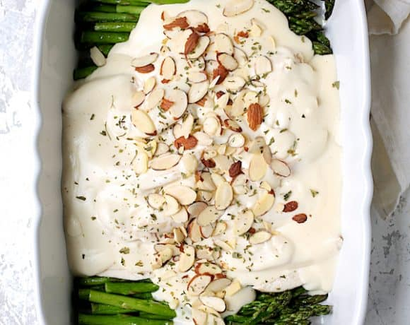 Chicken Asparagus Divan - Overhead hero shot of dish on white background in white baking dish