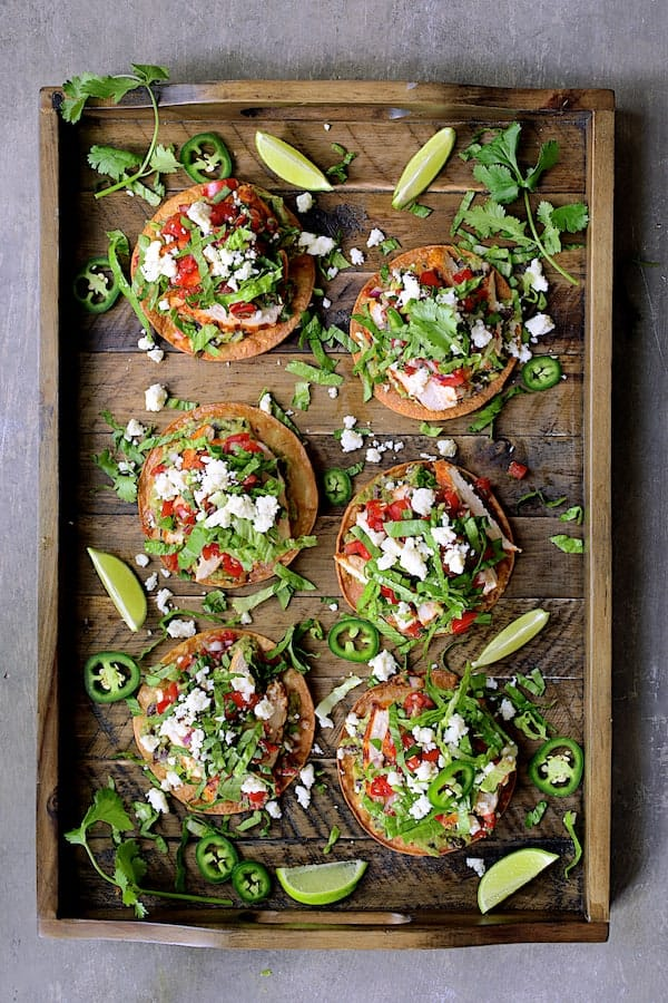 Chicken Tostadas with Black Bean Guacamole and Salsa Fresca - Overhead shot on wooden tray
