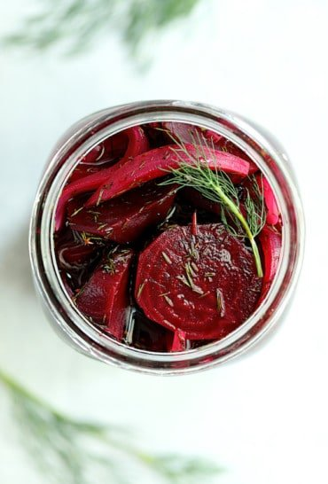 Quick Pickled Beets with Dill - Overhead shot looking into glass jar full of pickled beets