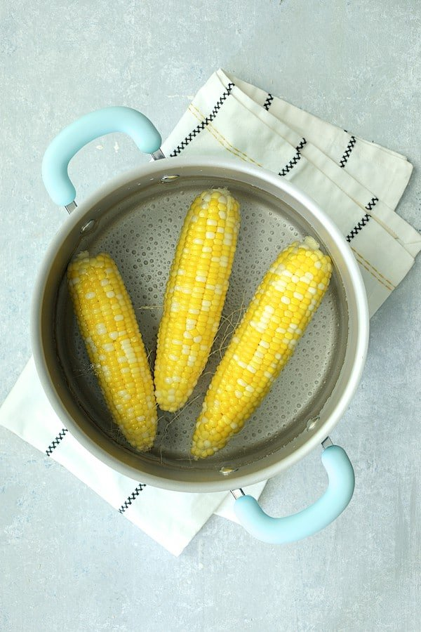 Overhead shot of corn after being parboiled in cookware