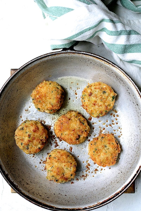 Overhead shot of shrimp cakes in skillet