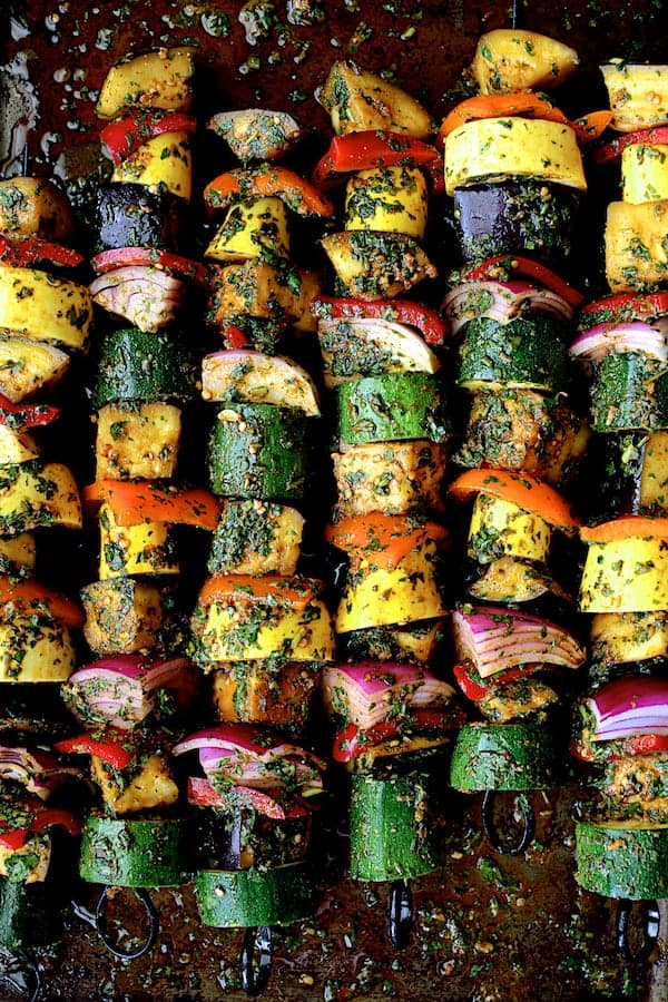 Grilled Vegetable Kabobs with Charmoula - Overhead close-up shot of skewers on baking sheet after being threaded on skewers