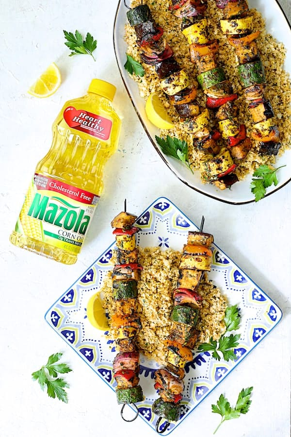 Photo of Grilled Vegetable Kabobs with Charmoula with some served on square plate with bottle of Mazola corn oil.