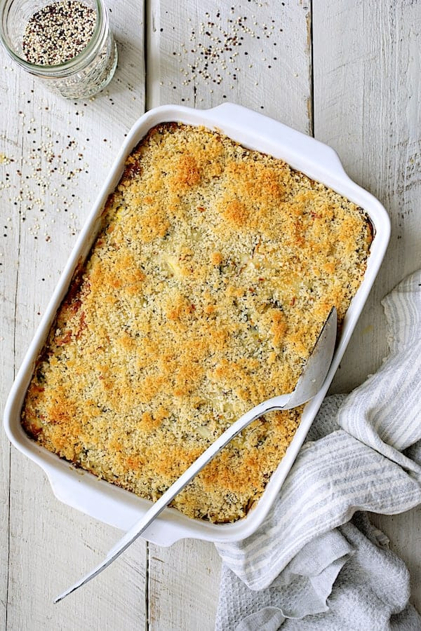 Zucchini, Yellow Squash and Quinoa Casserole - Overhead shot of baked casserole on white wood background