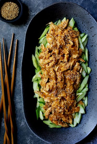 Sichuan Bang Bang Chicken - Overhead close-up shot of finished dish on black oval platter