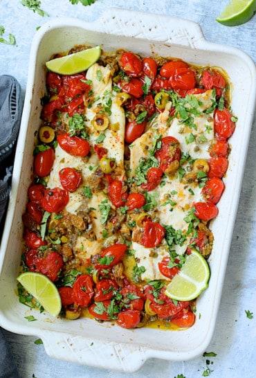 Baked Veracruz-Style Fish (Pescado A La Veracruzana) - Overhead hero shot of dish in white baking dish