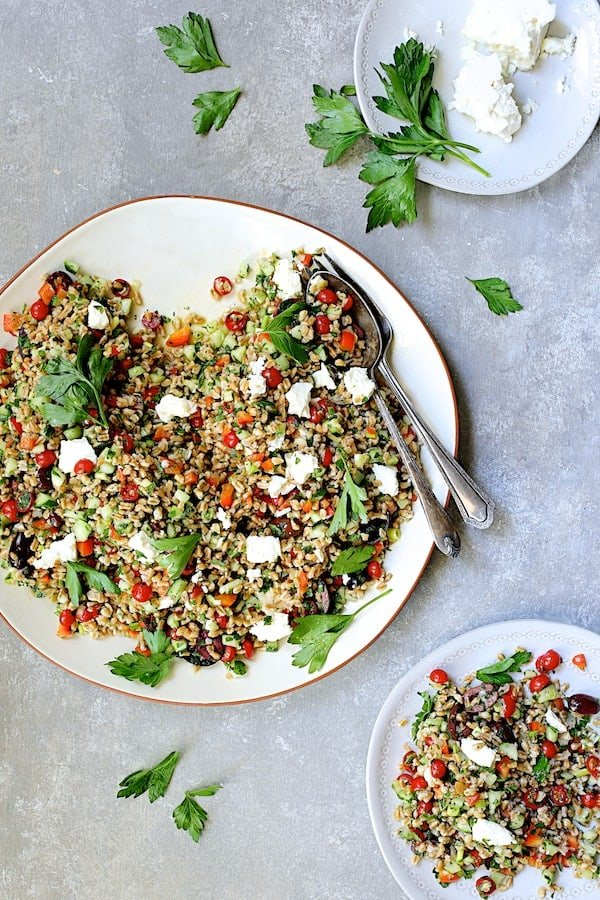 Mediterranean Farro Salad - Overhead shot of salad with some served on a smaller white plate