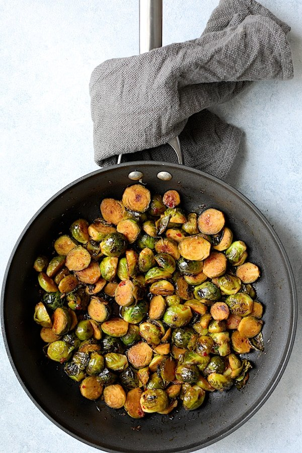 Pan-Roasted Brussels Sprouts with Thai Sweet Chili Orange Glaze - Brussels sprouts in nonstick skillet after having glaze added