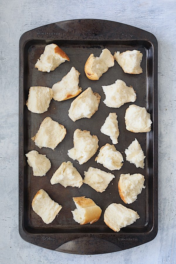 Overhead shot of unbaked croutons on baking sheet