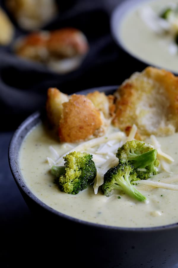 Broccoli Gruyere Soup with Torn Garlic Croutons - Close-up shot of soup in gray bowl