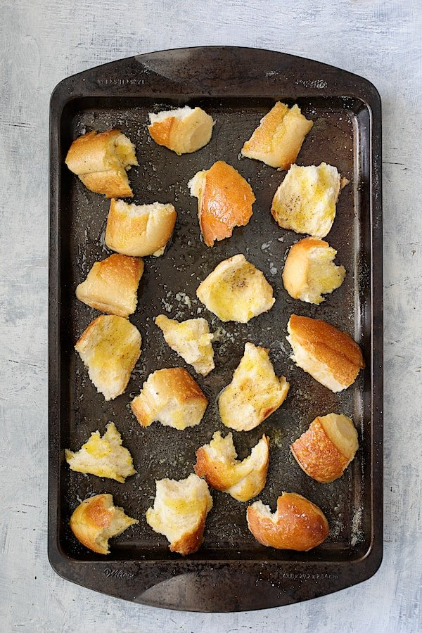 Overhead shot of baked croutons on baking sheet