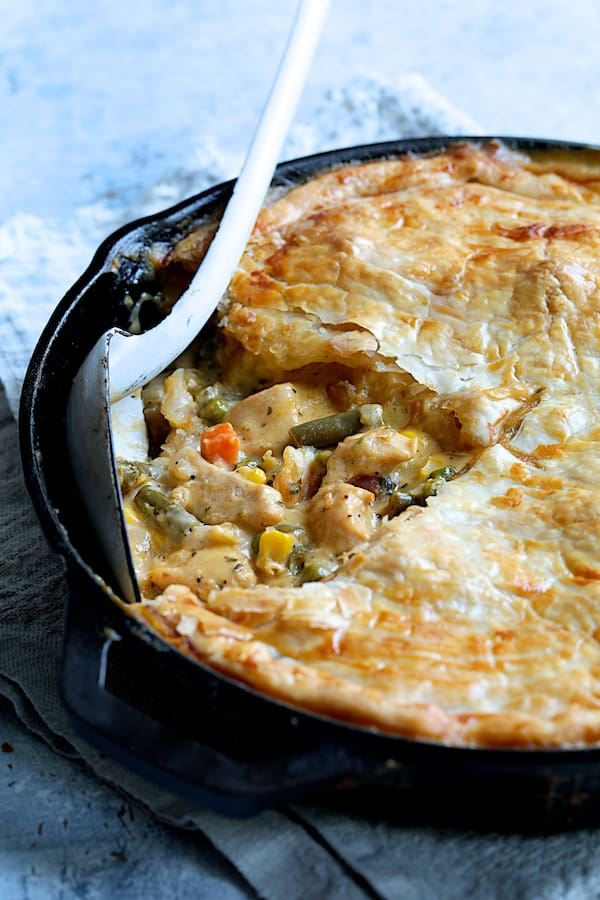 Cheesy Skillet Chicken Pot Pie - Straight-on close-up shot of inside of pot pie in cast iron skillet