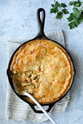 Cheesy Skillet Chicken Pot Pie - Overhead close-up shot with some served
