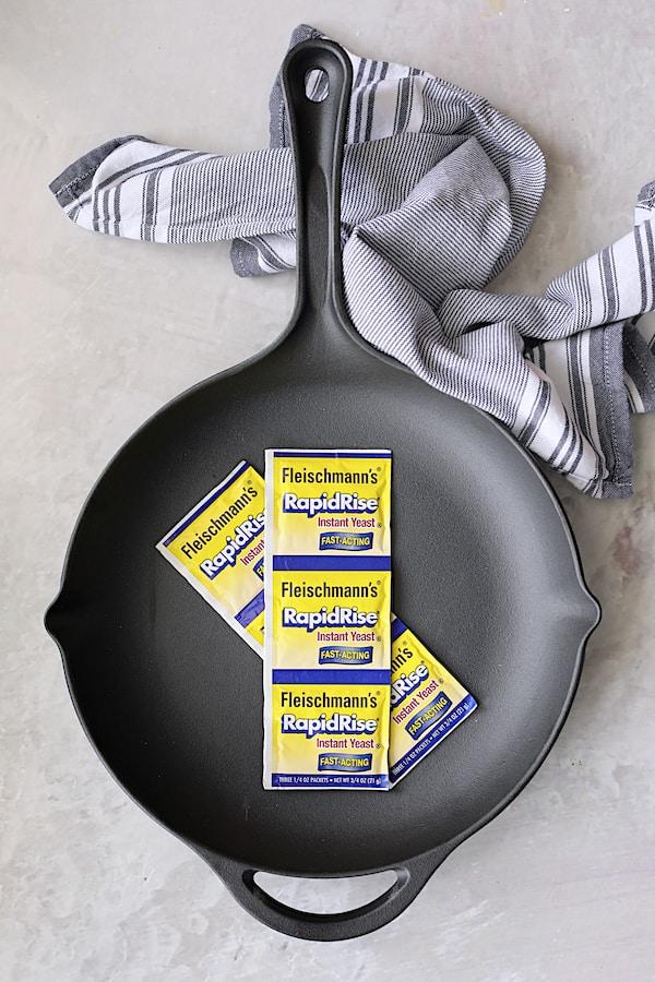 Overhead shot of Fleischmann's RapidRise Yeast in cast iron skillet