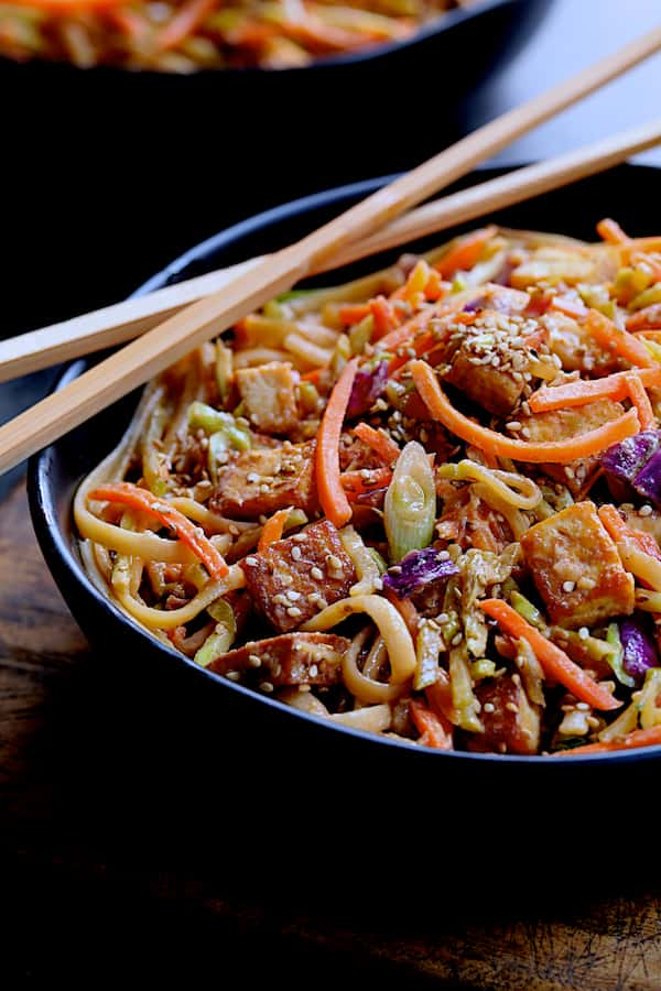 Thai Sesame Noodles with Tofu and Vegetables - Close-up shot of noodle dish in black bowl