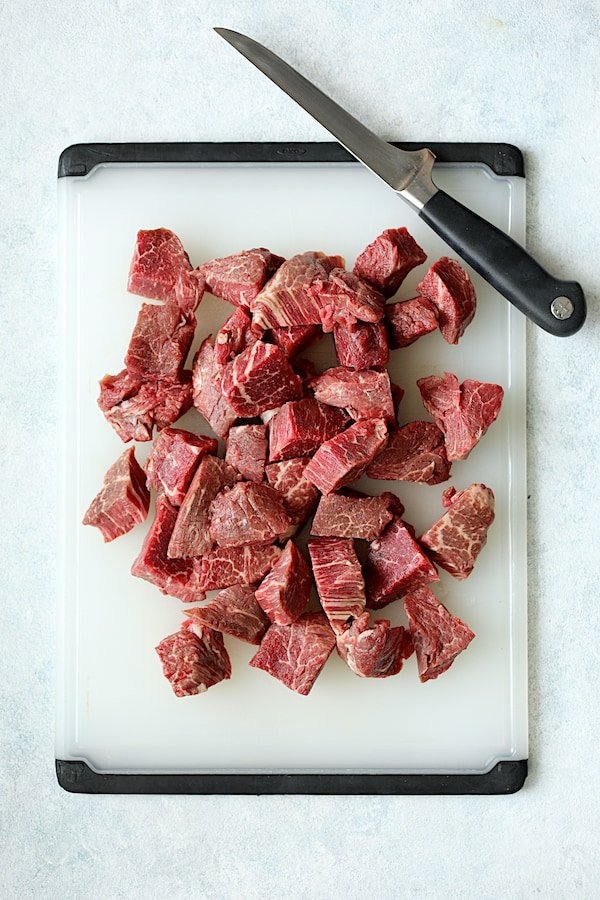 Overhead shot of steaks cut into bite-sized pieces