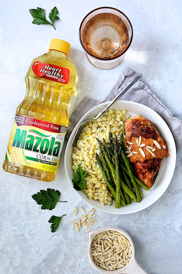 Chicken with Romesco Sauce and Saffron Cauliflower Rice - Overhead hero shot with bottle of Mazola