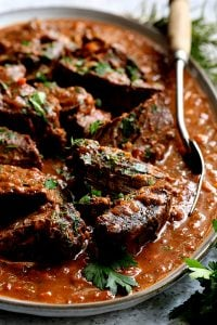 Italian Pot Roast (Straccato) and Oven-Baked Gorgonzola Polenta - Straight-on close-up shot of pot roast with meat fork