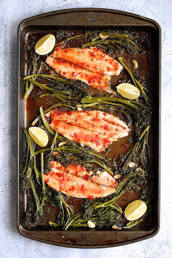 Overhead shot of fish and broccolini after being baked