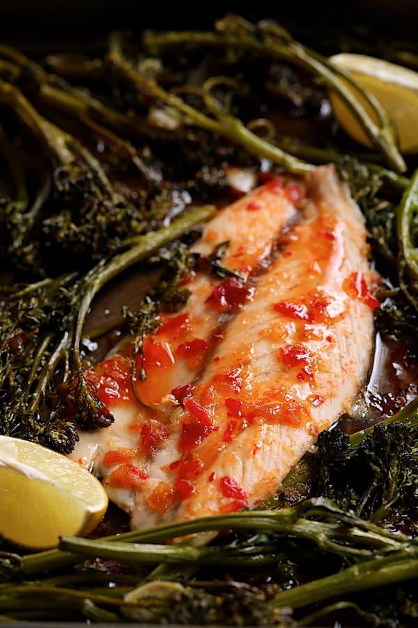 Sheet Pan Thai Sweet Chili -Lime Baked Fish with Garlic Broccolini - Close-up shot of fish on sheet pan