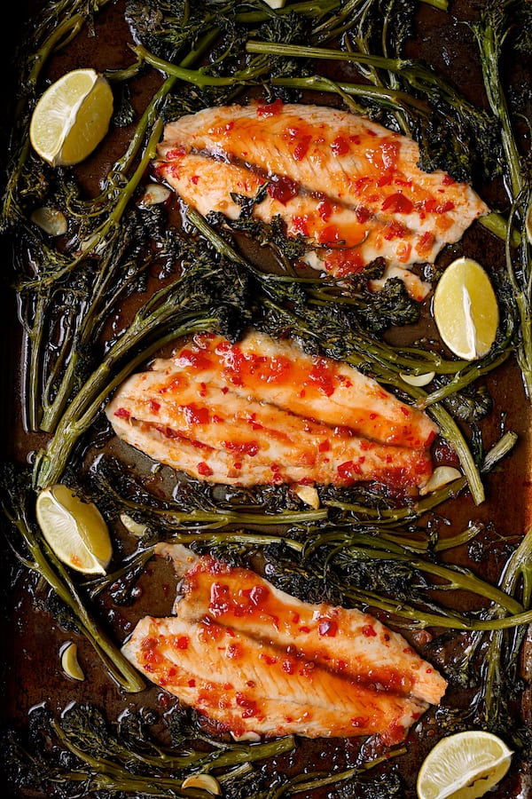 Sheet Pan Thai Sweet Chili Lime Baked Fish with Garlic Broccolini - Overhead hero shot of fish on sheet pan
