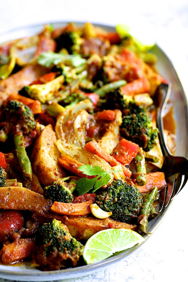 Curried Roast Vegetables - Straight-on close-up shot of vegetables on oval platter