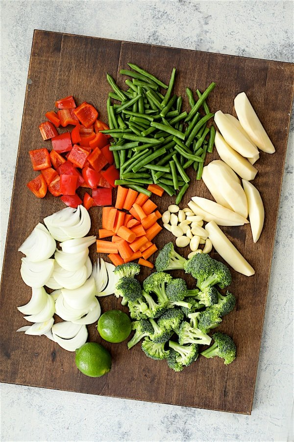 Overhead shot of cut vegetables on wood cutting board